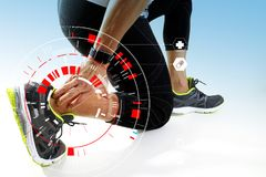 Athletic man touching foot due to sprain with VR medical scannin. Runner sportsman holding ankle in pain with Broken twisted joint running sport injury and Stock Photography