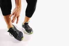 Runner sportsman holding ankle in pain with Broken twisted joint Royalty Free Stock Image