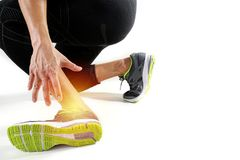 Runner sportsman holding ankle in pain with Broken twisted joint Stock Image