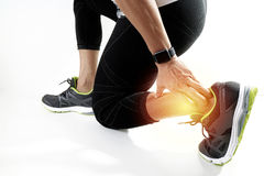 Runner sportsman holding ankle in pain with Broken twisted joint. Running sport injury and Athletic man touching foot due to sprain on white background stock images