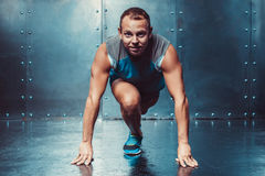 Runner, sportsman muscular man in a position of readiness, sport, run. Royalty Free Stock Photo
