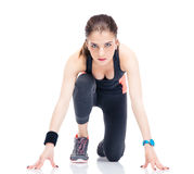 Runner sporty woman in start position Stock Images