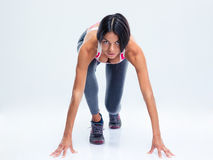 Runner sporty woman in start position Stock Photo