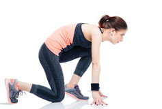 Runner sporty woman in start position Stock Photos