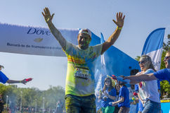 Runner sprayed with blue powder Royalty Free Stock Image