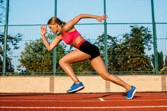 Runner sprinting towards success on run path running athletic track. Goal achievement concept. Stock Photos