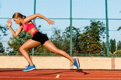 Runner sprinting towards success on run path running athletic track. Goal achievement concept. Stock Image