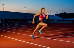 Runner sprinting towards success on run path running athletic track. Goal achievement concept. Stock Photo