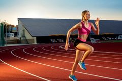 Runner sprinting towards success on run path running athletic track. Goal achievement concept. Royalty Free Stock Images