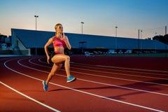 Runner sprinting towards success on run path running athletic track. Goal achievement concept. Stock Photos