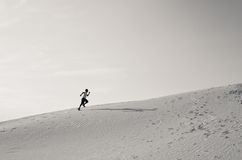 Runner sprints up desert hill Royalty Free Stock Photo