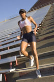 Runner on stadium stairs Stock Image