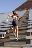 Runner on stadium stairs