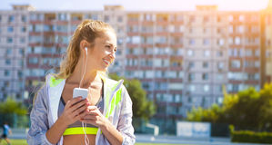 Runner on the stadium track. Woman summer fitness workout Royalty Free Stock Photos