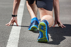 Runner in start position. Stock Photography
