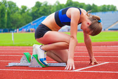 Runner at the start. Sports background Stock Photos
