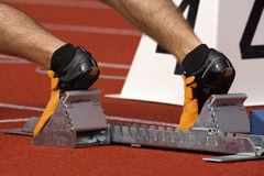 Runner in starting blocks Royalty Free Stock Photography