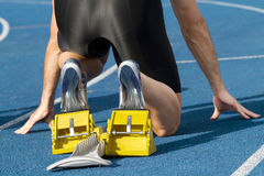 Runner starting blocks. Male runner waits for his start Royalty Free Stock Photos