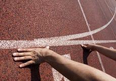 Runner at starting line Stock Photos