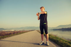 Runner starts his watch before training Stock Photography