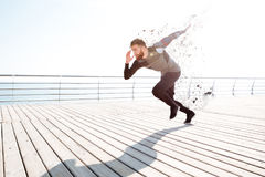 Runner starts near the sea. Full length image. side view royalty free stock photos