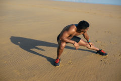 Runner stretching hamstring for warming up before running Royalty Free Stock Photo