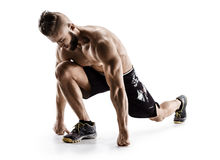 Runner stretching. Man does exercise for stretching muscles Stock Images