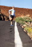 Runner stretching on road Royalty Free Stock Images