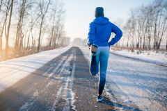 Runner stretching in winter Park. A healthy way of life. Runner stretching in winter Park. A healthy way of life Stock Photography