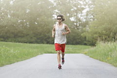 Runner with sunglasses Royalty Free Stock Photography