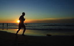 Runner at sunset, La Jolla Shore Stock Photo