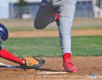 Runner tags home plate Royalty Free Stock Images