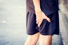 Runner touching painful leg. Athlete runner training accident. Sport running leg sprain Royalty Free Stock Photos