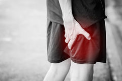 Runner touching painful leg Royalty Free Stock Photos