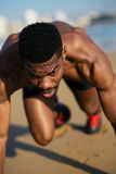 Runner training at the beach. Running and training motivation. Black runner on beach leg power outdoor workout for improving sprint Royalty Free Stock Image