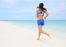 Runner training cardio running on beach Stock Photo