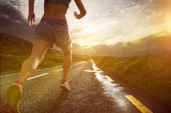 Runner. Traveling on the road stock photo