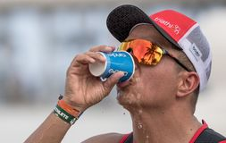 Runner triathlete drinking water at the Cozumel half Ironman 2017 royalty free stock photo