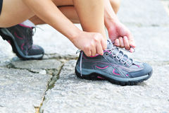 Runner try sports shoes. Runner try new sports shoes outdoor Royalty Free Stock Photo