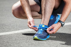 Runner trying running shoes getting Stock Photos
