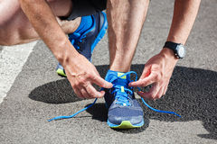 Runner trying running shoes getting Royalty Free Stock Photography
