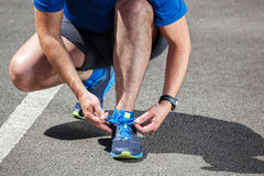 Runner trying running shoes getting Stock Images