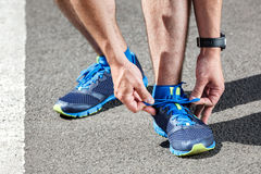 Runner trying running shoes getting Royalty Free Stock Image