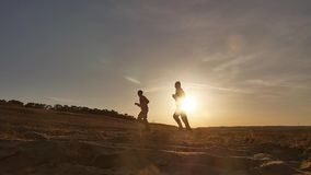 Runner. Two men running along the beach on the sand evening sunset sport sun, the runner. Runner. Two men running along the beach on the sand evening sunset stock video footage