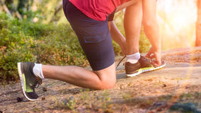 Runner tying his shoe laces. Young male runner tying his shoe laces Royalty Free Stock Photos
