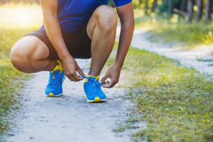 Runner tying shoelaces on sneakers. Stock Image
