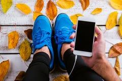 Runner tying shoelaces Stock Photo