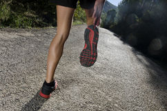 Runner warming up. Human legs in he road warming ready for jog, run or jump Royalty Free Stock Photo
