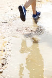 Runner on wet dirt path. Close up portrait of runner on wet dirt path Royalty Free Stock Photography