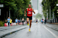 Runner winner of marathon running street in rain. Ekaterinburg, Russia - August 6, 2017: runner winner of marathon running street in rain during Europe-Asia Stock Images